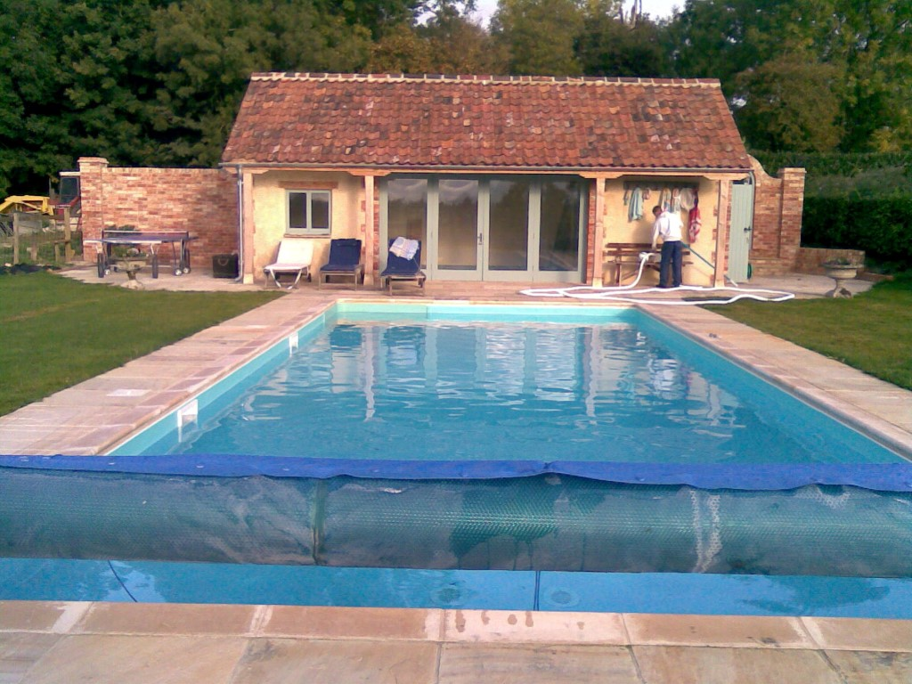 Maintenance on outdoor pool with pool house