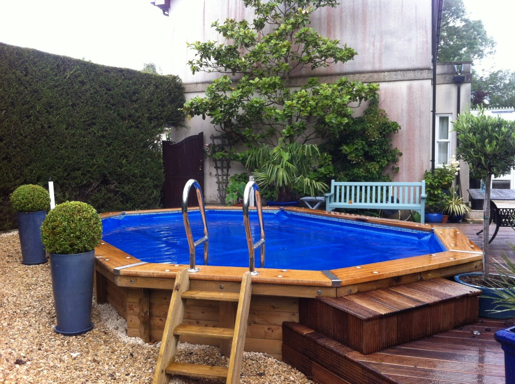 Octagonal Wooden Pool with blue cover