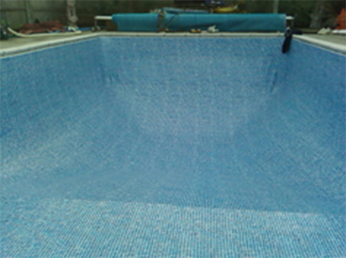 Empty outdoor pool with reel system and cover