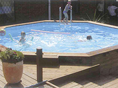 Octagonal Wooden Pool with kids in