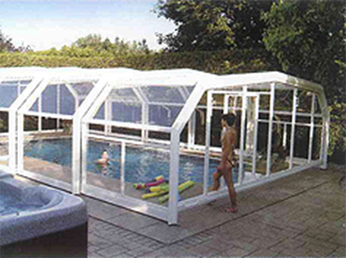 Outdoor swimming pool with glass cover on tiles