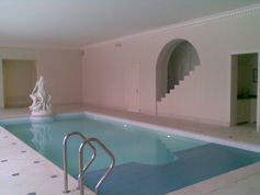 Indoor swimming pool with specialised cover covering half of the pool 3