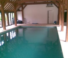pool inside wooden cover building with cover and reel system 3