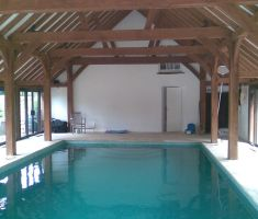 pool inside wooden cover building with cover and reel system 2