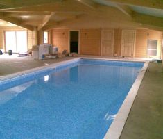 Competed pool in unfinished room