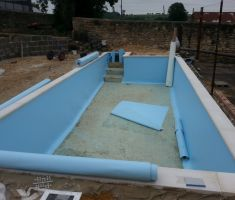Construction of outdoor pool in garden on a cloudy day