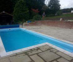 man constructing outdoor pool