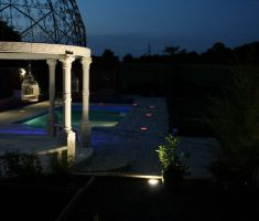 Outdoor pool lit up at night with LED lights 3