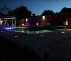 Outdoor pool lit up at night with LED lights 2