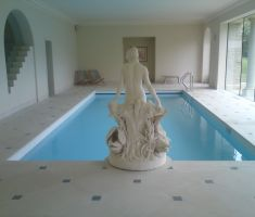 Indoor swimming pool with woman statue