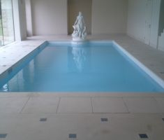 Indoor swimming pool with blue cover 2