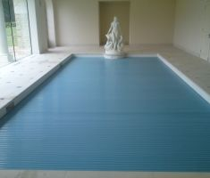 Indoor swimming pool with blue cover
