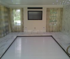 Indoor Marble Pool with TV on the wall