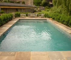 Outdoor pool on patio with seating area
